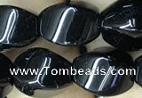 CAA2486 15.5 inches 10*14mm twisted rice black agate beads