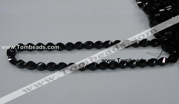CAB335 15.5 inches 8*12mm faceted & twisted rice black agate beads