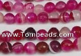 CAG2085 15.5 inches 6mm faceted round fuchsia line agate beads