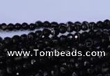 CAG2312 15.5 inches 4mm faceted round black line agate beads