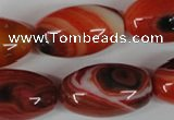 CAG3274 15.5 inches 16*30mm rice red line agate beads