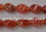 CAG4184 15.5 inches 6*10mm twisted rice natural fire agate beads
