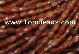 CAG597 15.5 inches 4*6mm faceted rice natural fire agate beads