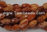 CAG599 15.5 inches 10*14mm faceted rice natural fire agate beads