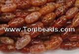 CAG604 15.5 inches 6*12mm rice natural fire agate beads wholesale
