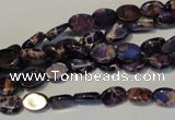 CDE414 15.5 inches 6*8mm oval dyed sea sediment jasper beads