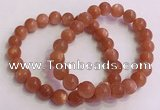 CGB4539 7.5 inches 9mm round golden sunstone beaded bracelets