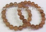 CGB4614 10mm - 11mm round golden rutilated quartz beaded bracelets