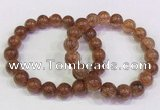 CGB4621 10mm - 11mm round golden rutilated quartz beaded bracelets