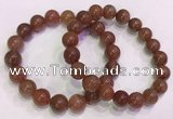 CGB4627 10mm - 11mm round red rutilated quartz beaded bracelets