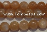 CMS703 15.5 inches 10mm round peach moonstone beads wholesale