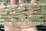 CRI132 15.5 inches 10*30mm faceted rice lemon quartz beads