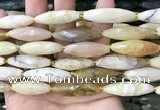 CRI143 15.5 inches 10*30mm faceted rice yellow opal gemstone beads
