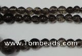 CRO743 15.5 inches 6mm � 14mm faceted round smoky quartz beads