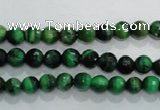 CTE1011 15.5 inches 6mm faceted round dyed green tiger eye beads