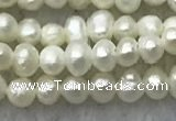 FWP05 14.5 inches 2mm - 2.5mm potato white freshwater pearl strands
