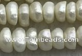 FWP321 14.5 inches 5mm - 6mm button white freshwater pearl strands