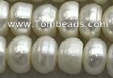 FWP322 15 inches 6mm - 7mm button white freshwater pearl strands