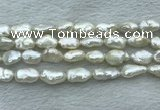 FWP353 15 inches 9mm - 10mm baroque white freshwater pearl strands